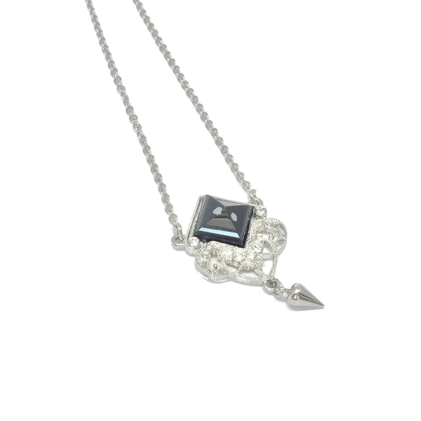 Delicate silver necklace with natural black and grey obsidian stone and small teardrop charm
