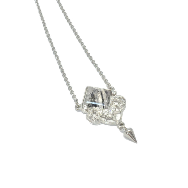 Delicate silver necklace with natural clear and black rutilated quartz stone and small teardrop charm