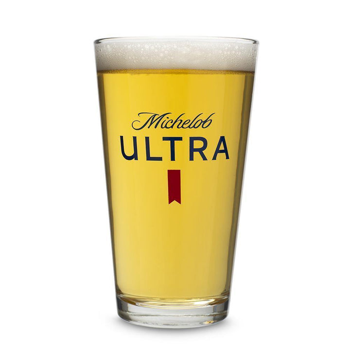 Michelob Ultra straight walled pint glass. Branded on one side with Michelob Ultra logo in blue and red ribbon.  Can also be customized for the perfect Birthday, Groomsmen, Engagement or Father's day gift.