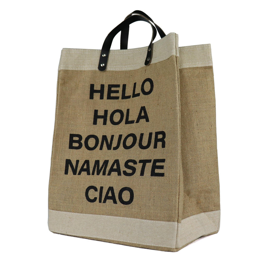 "100% golden jute tote bag. Tan with cream border and black handles. ""HELLO"", ""HOLA"" , ""BONJOUR"", ""NAMASTE"", ""CIAO"" in black capital letters."