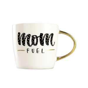 "a 14 ounce coffee mug with a metallic gold handle. Displays ""mom fuel"" with mom in a cursive font and in black with gold polka dots, while fuel is in a smaller font black in all caps. There is a gold dash on both sides of the word fuel."