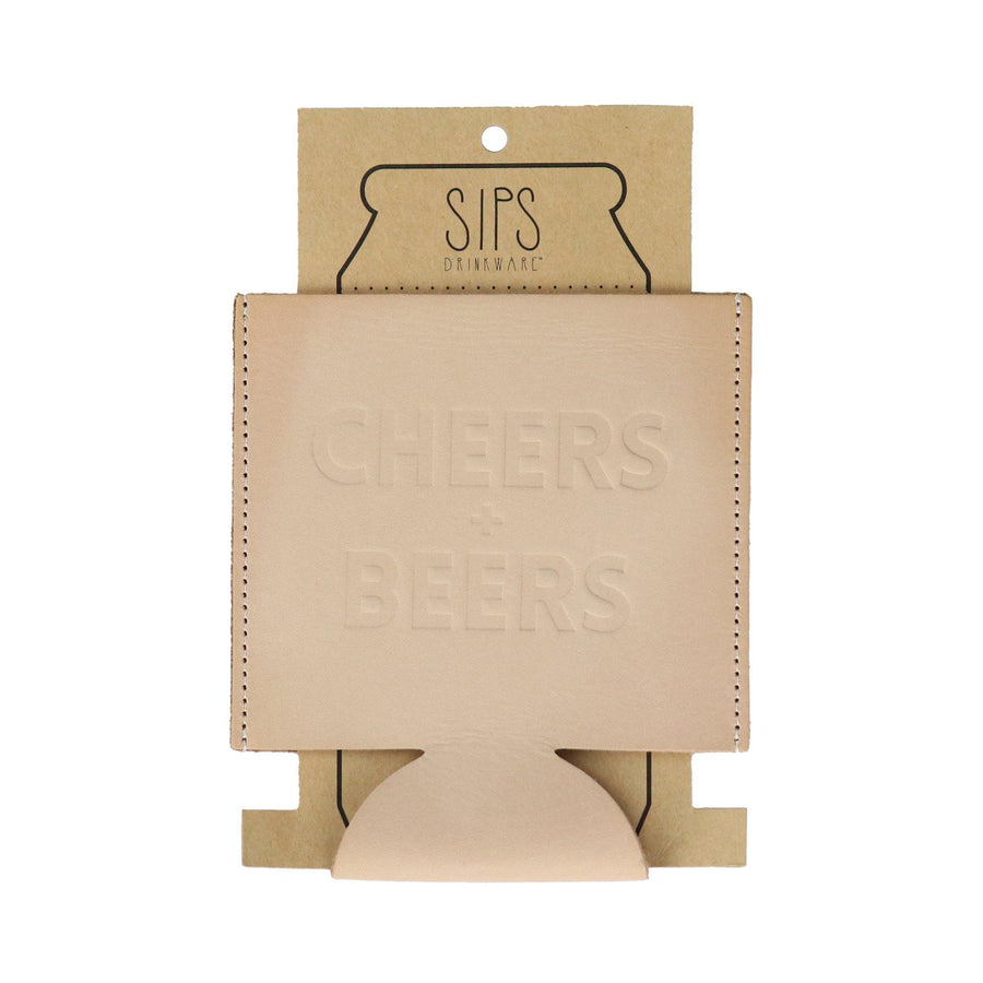 "beige leather insulated can coolie that has ""CHEERS + BEERS"" debossed on one side"