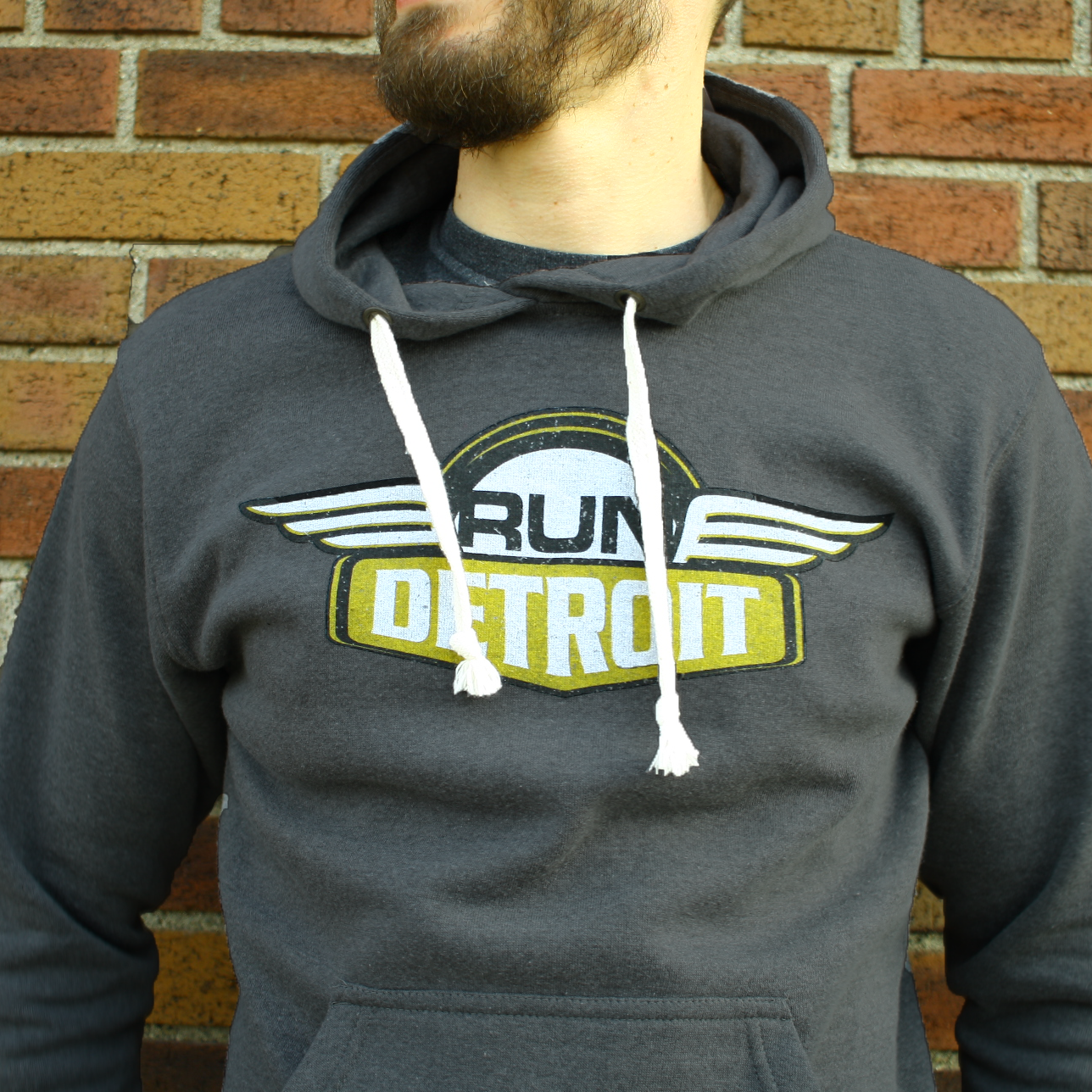 Unisex Triblend Pullover Fleece Hoodie Sweatshirt with distressed RUNdetroit logo screen printed on chest