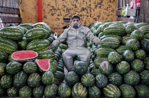 Watermelon vendor in Lima wearing mask during COVID-19 pandemic