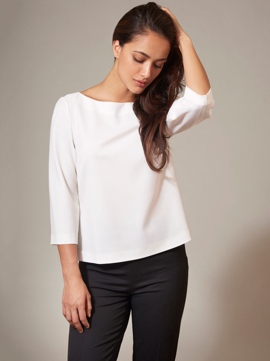 Women's white top in exquisite light weight fine wool