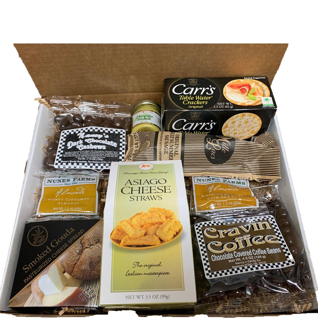 We could all use a little pick me up. Are We There Yet is our signature pick me up gift to send to your loved one or enjoy yourself, because you deserve it! Gift box includes a 3.5 oz box of Roasted Almonds with Sea Salt, a 5 oz Original Beef Summer Sausage, 1.4 oz of your choice of Mustard, 3.75 oz of Smoked Gouda Cheese, a 3.5 oz box of Asiago Cheese Straws, a 3.5 oz box of water crackers, a 4.5 oz bag of Dark Chocolate Cashews and a 4.5 oz bag of Chocolate Covered Coffee Beans.