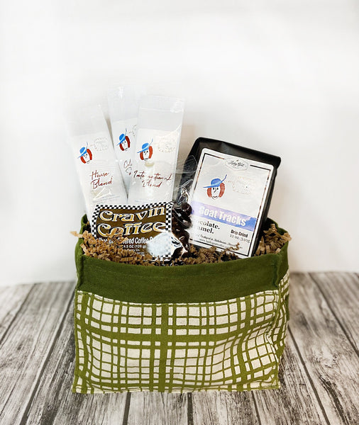 For some, coffee is everything. So c'mon... give them everything! This basket features an adorable reusable tote, your choice of 3 1.5 oz Lucky Goat Coffee, 1 4.5 oz bag of Cravin Coffee Chocolate Covered Coffee Beans and 1 12 oz bag of Lucky Goat Goat Tracks.