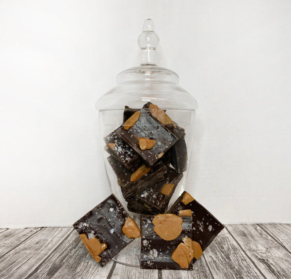 Revel in the perfect combination of salty, sweet and crunchy!  Jar includes a pound and a half of gourmet dark chocolate salted caramel bark with your choice of ribbon. Add your custom message at checkout!