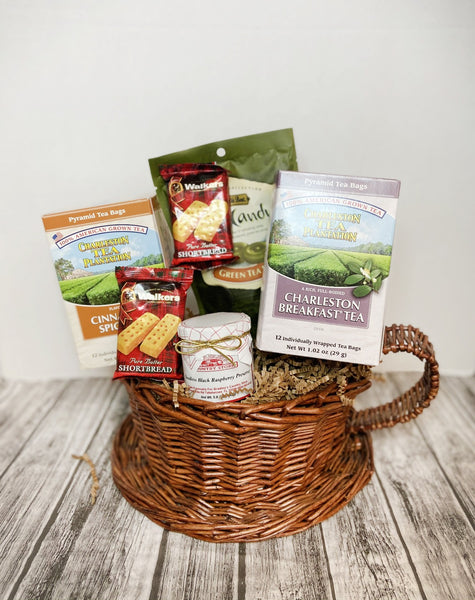 Enjoy 100% American grown tea with your favorite friend! Basket features 1 12 ct box of Cinnamon Spice Tea, 1 12 ct box of Charleston Breakfast Tea, 1 5.3 oz bag of Green Tea Latte Candy, 1 5 oz jar of Seedless Black Raspberry Preserves and 2 1.4 oz pack of Shortbread Cookies.