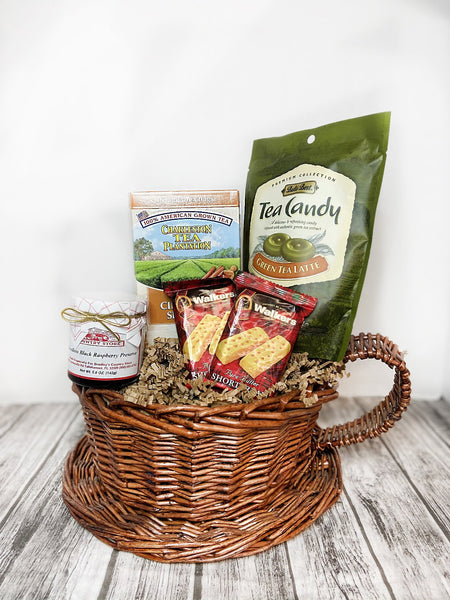 Enjoy 100% American grown tea with some goodies! Basket features 1 12 ct box of your choice of Tea, 1 5.3 oz bag of Green Tea Latte Candy, 1 5 oz jar of Seedless Black Raspberry Preserves and 2 1.4 oz pack of Shortbread Cookies.