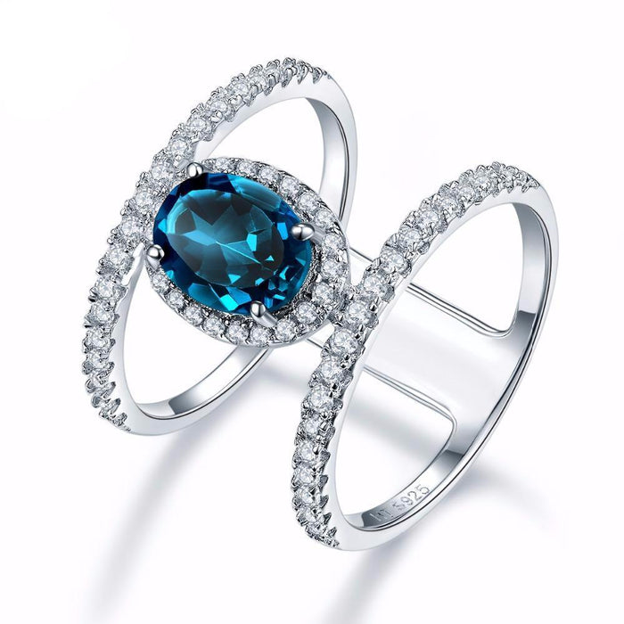 Berneen Blue Oval Topaz & Zirconia Ring