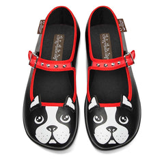 Black mary jane style flat shoes with the design of a french bulldog's face on the tip and synthetic fabric ears sticking out. The lining is red as well as the buckle strap, which is lined with little spikes like a dog collar