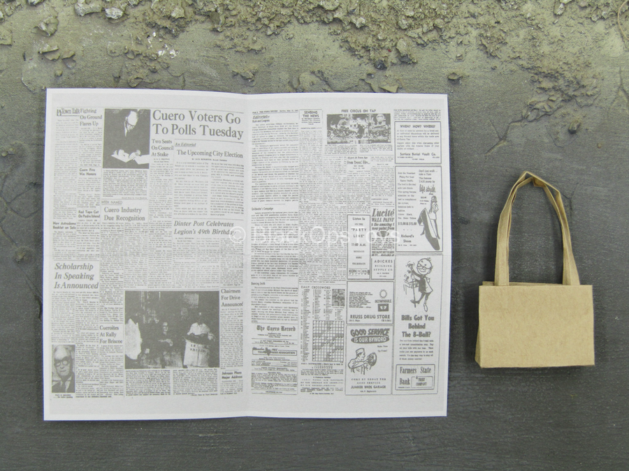 The Entertainer - Newspaper w/Tan Bag