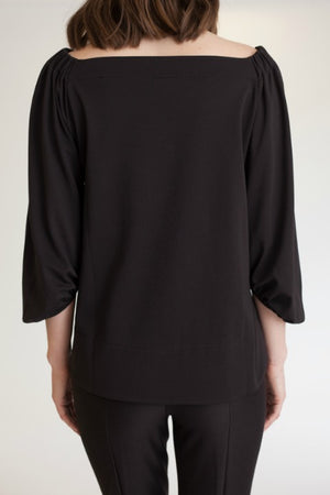 Buki's Cold Shoulder top can be worn from desk to dinner.
