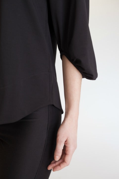 Buki's Cold Shoulder top features a 3/4 raglan sleeve.