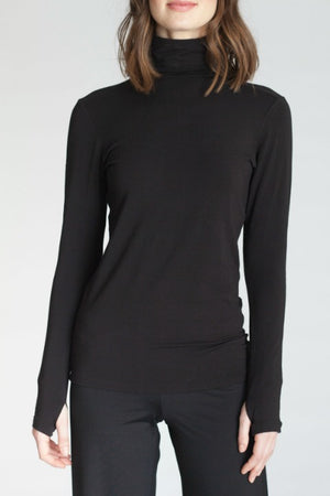 The women's Collagen Turtleneck will make your skin super soft.