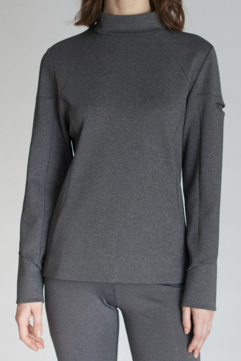 Buki's Mock Up Pullover features a left sleeve pocket to keep your essentials close.