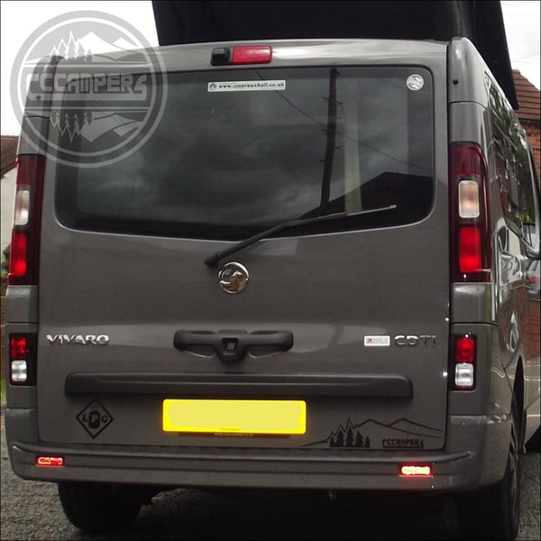 Nissan Factory option 90 degree glazed tailgate door with wash & wipe