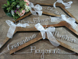 set of hangers, walnut hangers, hangers on wooden background, wire hangers, Personalized hangers, name hangers, silver wire, white bows