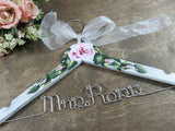 Brown wood background, flowers, Mrs Ross wedding dress hanger, white crackle painted hanger, roses, flowers