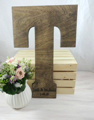 large wood letter, walnut letter, engraved names and date, guest book, crate, flowers