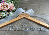 Mrs Benson, engraved wedding hanger with pink flower background, pecan stained handmade hanger, with ribbon