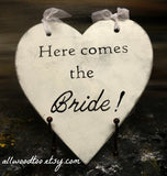 Here comes The Bride heart shaped wooden sign on black stand