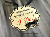 With these RINGS we say I DO! wooden wall hanging on gray background