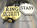 2 wedding signs, wedding security sign set, gold ring bearer sign, silver staff sign, black lettering, black ribbons, gray background, silver wire rings