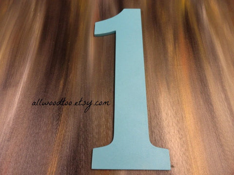 1 one blue number photo prop on wooden background