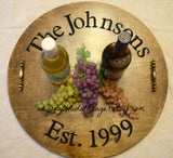 The Johnsons Est. 1999 rustic serving tray with wine bottles and grapes