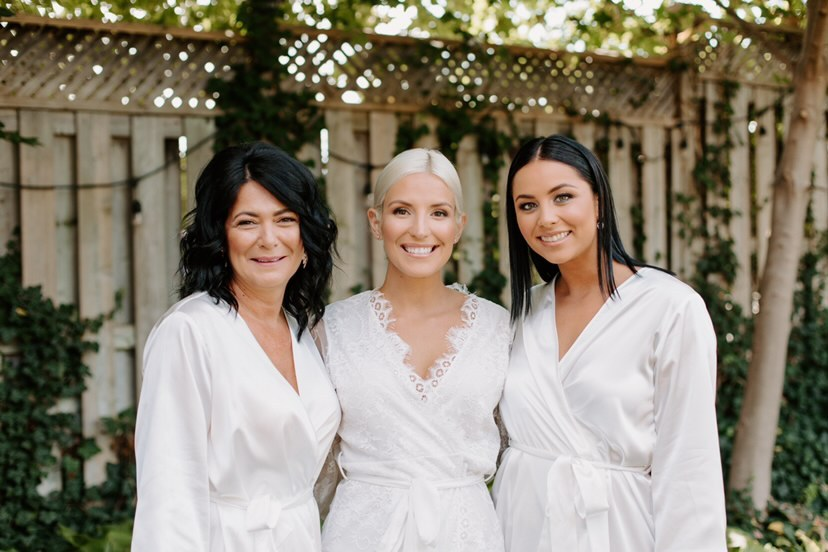 ontario bridal party getting-ready in white bridal robes from by catalfo