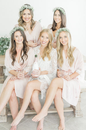 Bridal party blush robes for getting ready, with lace details, from by catalfo in Toronto