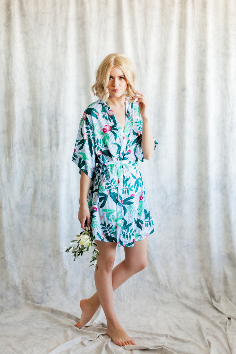 Amalia bridesmaid robe from By Catalfo with blue and white stripes and tropical floral print