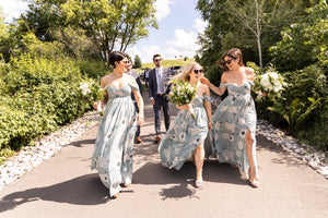 bridesmaids wearing floral dresses in toronto, with bouquets