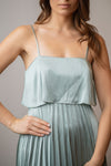 close up front view of sage green midi length bridesmaid dress