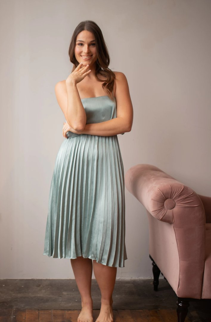 sage green party dress with pleated skirt