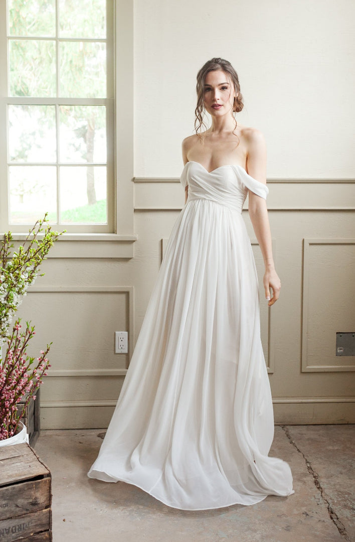 simple wedding gown with off the shoulder sleeves, strapless gown