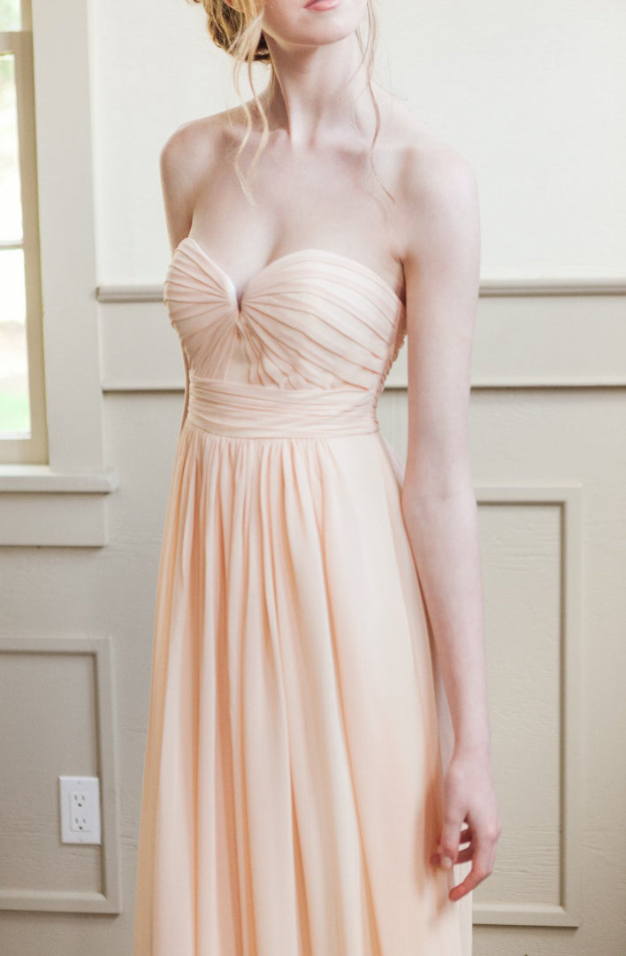 strapless bridesmaid gown for a modern wedding, with bodice pleating.