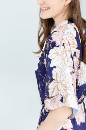 Sleeve detail of a navy, blush and gold floral print bridesmaid robe for getting ready or bridesmaid gift in toronto