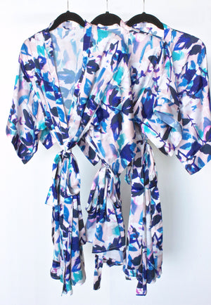 set of bridesmaid robes from by catalfo in navy, blush pink and lavender