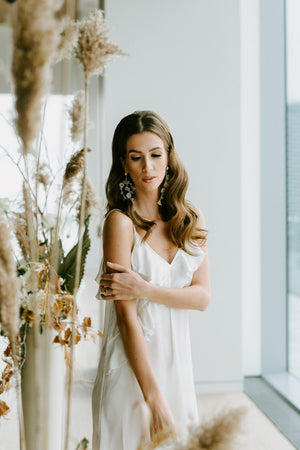 Simple, white bridal slip dress with ruffle for a modern wedding