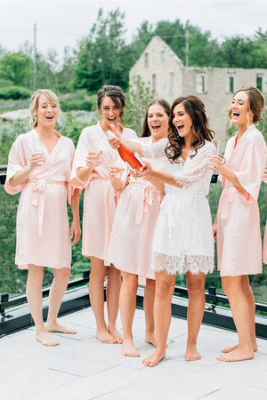 wedding day celebrations at Elora Mill wearing by catalfo bridal robes