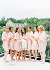 bridesmaids getting ready at Elora Mill wearing By Catalfo silk robes