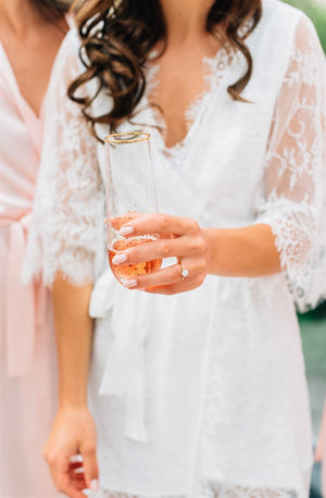 real bride at Elora Mill toasting in By Catalfo Lara Lace Robe