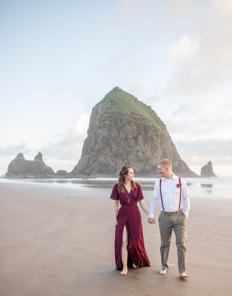 burgundy wrap dress for engagement session at haystack rock, oregon