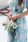 bridesmaid inspiration with sage green dress and bouquet