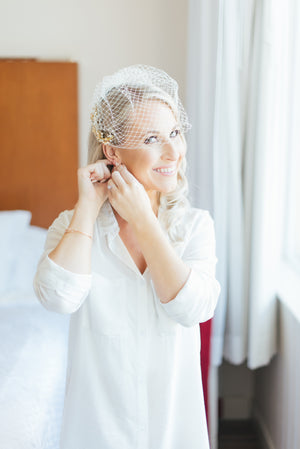 a bride wearing by catalfo boyfriend while getting ready on her wedding day
