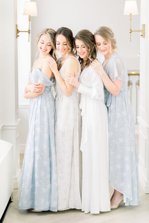 bridal party wearing off the shoulder simple and modern bridesmaid dresses