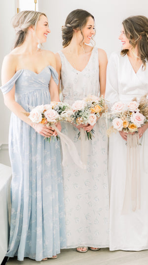 bridesmaids wearing off the shoulder simple and modern bridesmaid dress